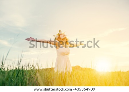Freedom concept : Young beautiful woman enjoying with fresh air and nature at meadows. with sunrise
