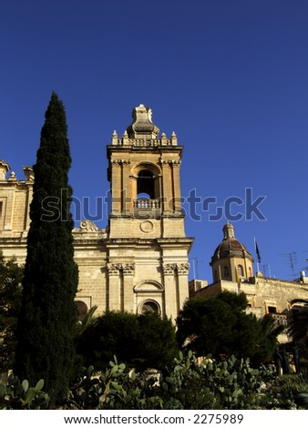 Freedom Day Monument in Malta, overlooked by medieval church - stock photo