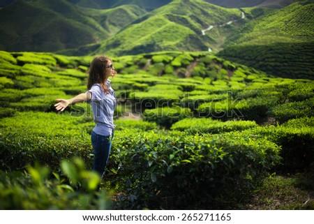 freedom girl in mountains on tea plantation - stock photo