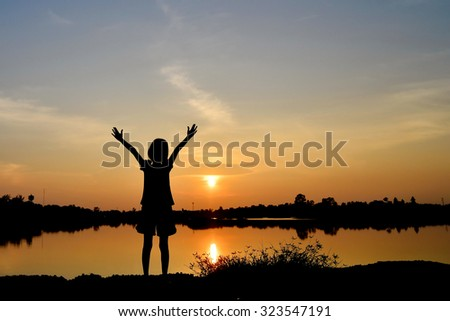 freedom girl in sunset background