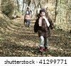 Freedom: Happy little girl running on a forest footpath - stock photo