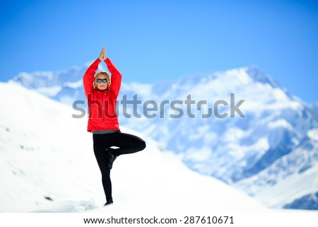 Freedom happy yoga meditation on snow. Yoga, fitness with motivation and inspiration for healthy lifestyle, beautiful landscape, snow in Himalaya winter mountains Annapurna region, Nepal. - stock photo