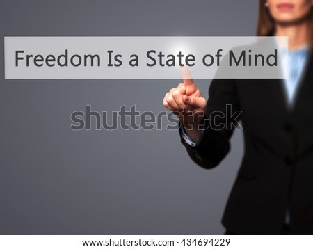 Freedom Is a State of Mind - Businesswoman hand pressing button on touch screen interface. Business, technology, internet concept. Stock Photo - stock photo