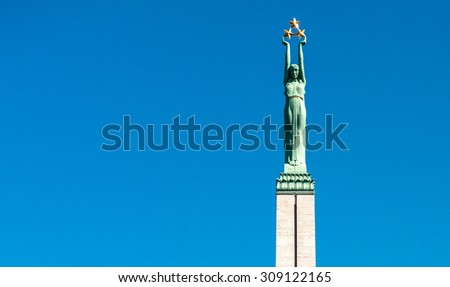 Freedom Monument known as Milda, located in the centre of Riga, the capital of Latvia. Riga is European Capital of Culture 2014  - stock photo