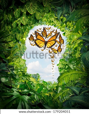 Freedom of thought  and human intelligence symbol on a green jungle landscape shaped as a head and a group of flying monarch butterflies in the shape of a brain as a mental health and education icon. - stock photo