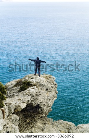 freedom on the sea cliff - stock photo