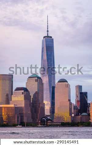 Freedom Tower and New York City Manhattan skyline over Hudson River viewed from New Jersey at sunset. - stock photo