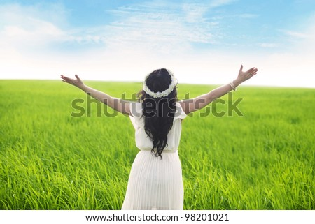 Freedom: Woman with opened arms enjoying the view - stock photo