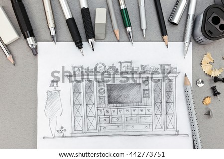 freehand sketch of living room furniture with various pencils, eraser, sharpener, top view - stock photo