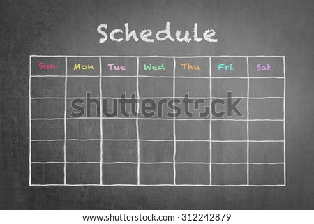Freehand white chalk doodle sketch of blank monthly grid timetable schedule on black chalkboard background: Hand drawn study plan on blackboard with weekly date written in colorful pastel color      - stock photo
