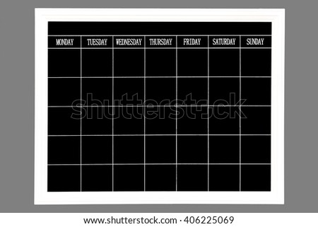 Freehand white chalk doodle sketch of blank monthly grid timetable schedule on black chalkboard background: Hand drawn study plan on blackboard with weekly date - stock photo