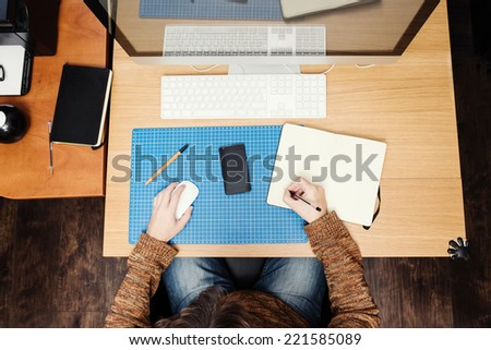 Freelance developer or designer working at home, workplace view - stock photo