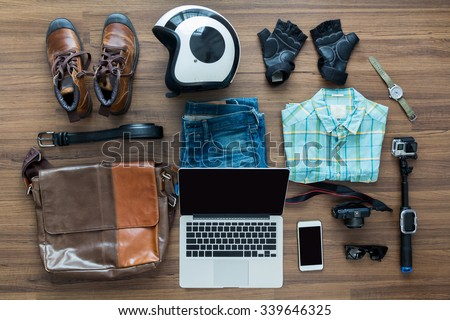 Freelancer needs mock up on wooden table in home interior, laptop computer, hipster clothes and accessories electronic business and distance work concept, View from above top view with copy workspace - stock photo