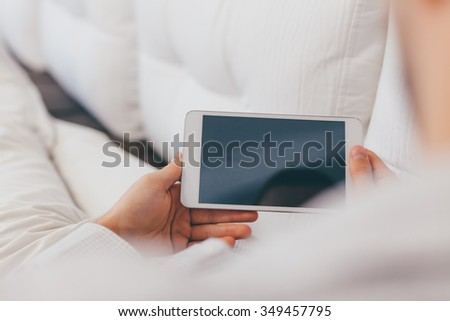 Freelancer Working on Tablet at Home. Blurred background. - stock photo