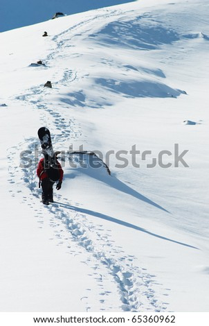 Freeride on snowboard in winter mountain