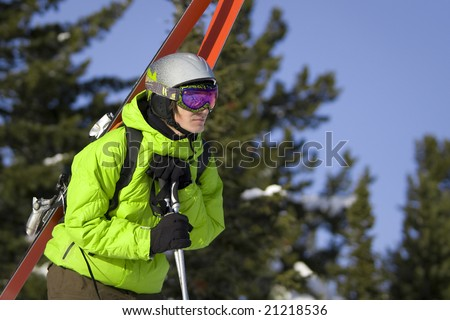 Freeride skier looking for a ride - stock photo