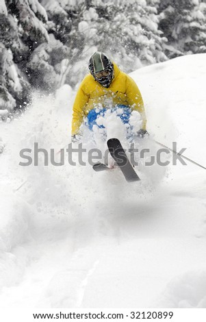 Freeride Skier moving down and  jumping in powder snow. - stock photo