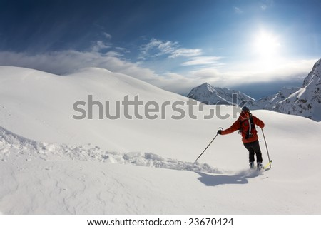 Freerider skier moving down in snow powder; italian alps.