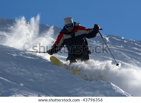 Freerider skiing in powder snow in a Caucasus mountains