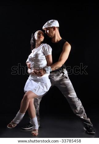 freestyle dancing couple on black - stock photo