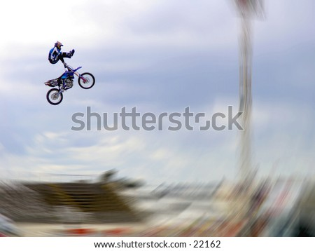 Freestyle Motorcross stunt. - stock photo