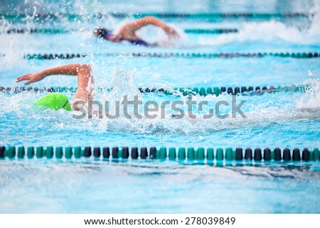 Freestyle race . Focus on water splash - stock photo