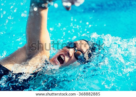 Freestyle swimming action - stock photo