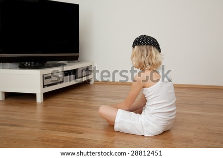 Freetime in childhood watching tv - stock photo