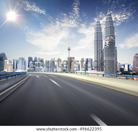 freeway at sunny blue sky motion blur with city background