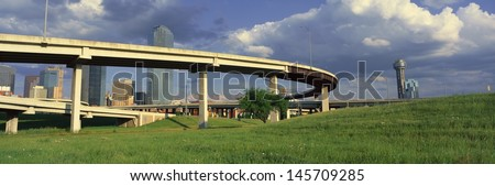 Freeway overpass with Reunion Tower in the background, Dallas, TX - stock photo