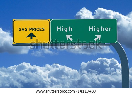 Freeway sign on blue cloudy skies reading, Gas prices - high and higher - stock photo
