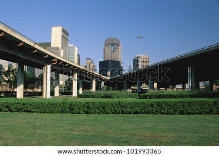 Freeway with Dallas beyond - stock photo
