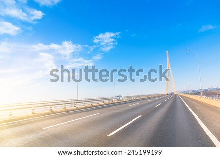 freeway with sky background. - stock photo