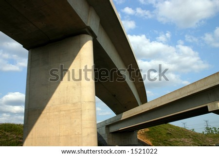 Freeways crossing on sky background.
