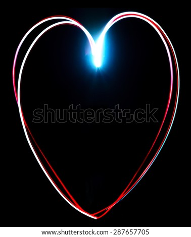 Freeze light painted heart on a black background - stock photo