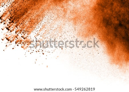 Freeze motion of colorful powder paint isolated on white background. Particles explosion screen saver or wallpaper or brush.