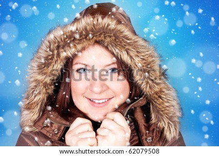 freezing girl and snowflakes on blue background