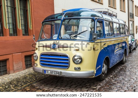 FREIBURG, GERMANY - JULY 29, 2014: famous old bus type SETRA S6 from 1953 transports people to touristic evvents in Freiburg, Germany. - stock photo