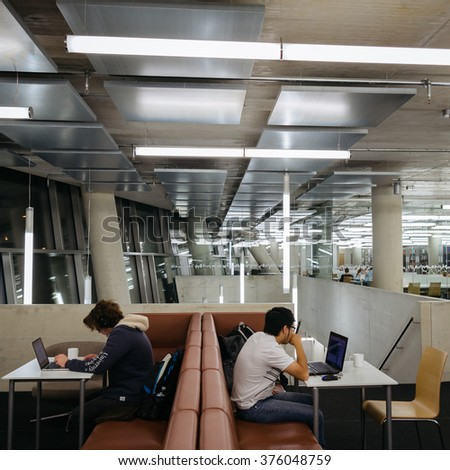 FREIBURG, GERMANY - OCTOBER, 2015: Images of the interior and outside of the newly built University Library in Freiburg, Germany in 10/15. Images show modern concrete architecture and surroundings  - stock photo