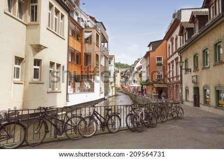 """FREIBURG IM BREISGAU, GERMANY - AUGUST 6, 2014: Area """"Little Venice"""" in Freiburg, a city in the south-western part of Germany in the Baden-Wurttemberg state. - stock photo"""