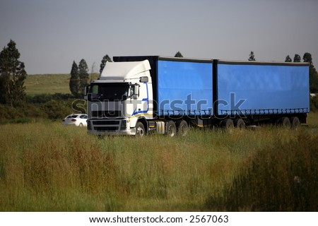 Freight carrier travelling in the countryside - stock photo
