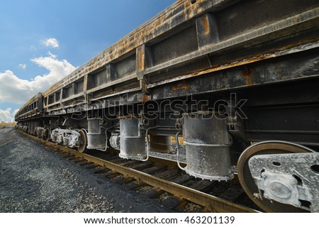 Freight cars at the railway. Wheels and wheel truck with three axles