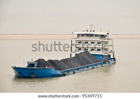 freight ship on the yangtze in china - stock photo