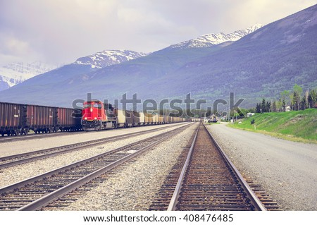 Freight train arrives to Jasper station. Alberta. Canada.  - stock photo