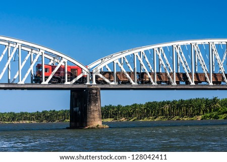 Freight train crossing the river on the bridge in eastern Madagascar