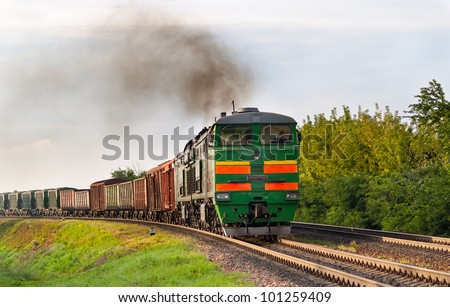 Freight train hauled by diesel locomotive. Belarusian railway - stock photo