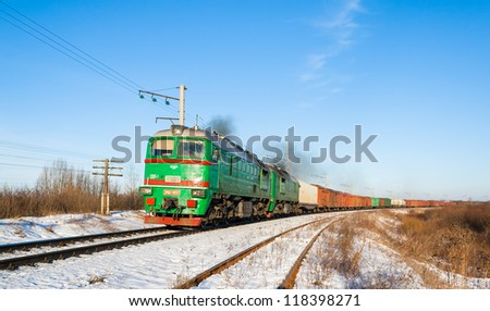 Freight train hauled by diesel locomotive. Ukrainian railways - stock photo
