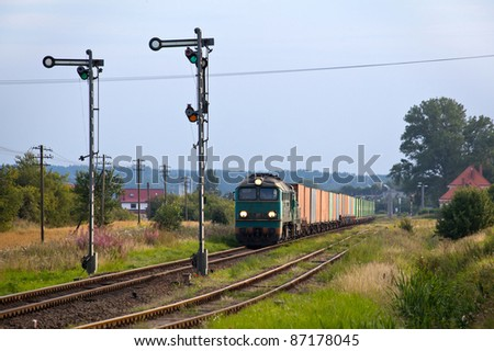 Freight train hauled by the diesel locomotives stopped on the station - stock photo