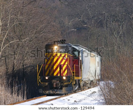 Freight train in the snow. - stock photo