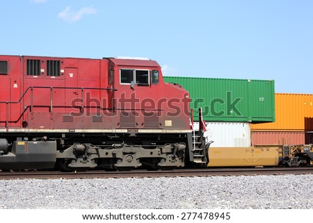 Freight train locomotive and cargo containers - stock photo